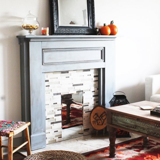 Make your own Faux Fireplace Mantel to warm up any space! Perfect for the holidays and rentals!