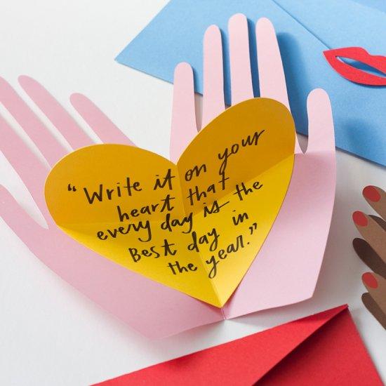 Hand holding heart pop up card